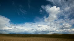 Time Lapse of Clouds and Tractor Harrowing Field Stock Footage