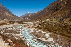 Village and drained river in himalaya Stock Photos
