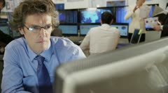 Confident and mature financial trader is concerned when the stock market crashes Stock Footage