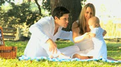 Proud Young Couple with Baby Outdoors Sunshine - stock footage