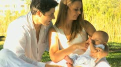 Caucasian Parents Outdoors Baby Son Sunshine Stock Footage