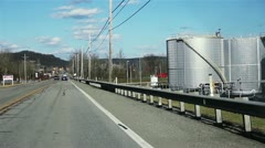 Drive along Roadway in Industrial Area - stock footage