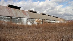 Cloud Timelapse of Remote, Rundown Storage Building in a Field of Tall Grass Stock Footage