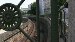 Subway in Vienna framed by bridge parapet Stock Footage