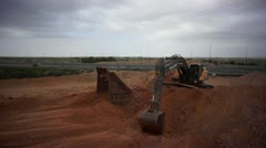 Excavator diging in the sand Stock Footage