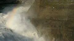 Rainbow over thundering waterfall Stock Footage
