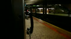NYC subway station with train entering Stock Footage