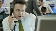 Confident and mature stock market trader doing a deal over the phone Stock Footage