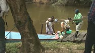 Stock Video Footage of Suriname, Grand Rio river, woman step out of boat