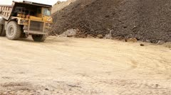 Dump Truck Driving in Excavation Site Stock Footage
