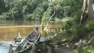 Stock Video Footage of Suriname, longboats in river Awarradam