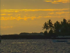 Stock Video Footage of Sunset with Palm Trees and Canoes