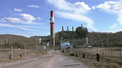 Clouds over the Smokestack of a Coal Plant - stock footage