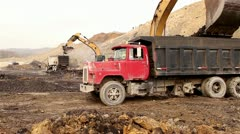 Backhoe Loading Small Truck - stock footage