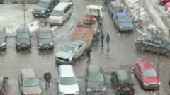 Defocused view of snowfall with car towing, Russia Stock Footage