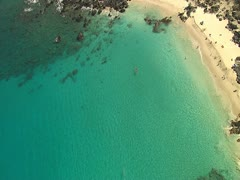 Kua Bay with 2 Man Outrigger Canoe and Beach - stock footage