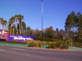 Stock Video Footage of Orlando Florida Theme Park Main Gate News Footage of Cars on Road Trip Vacation