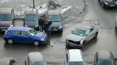 Drivers after road accident looking at broken cars - stock footage