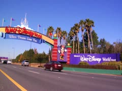 Orlando Florida Theme Park Main Gate News Footage of Cars on Road Trip Vacation Stock Footage
