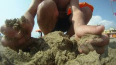Playing with sand - stock footage