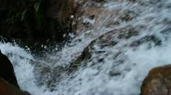 Looking down waterfall as water rushes over the edge Stock Footage