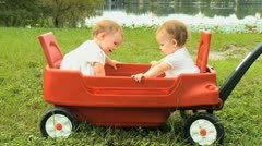 Twin Sisters Play Toy Outdoors Stock Footage