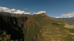 Pan to inca trail and fortress on mountain - stock footage