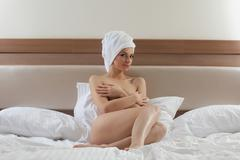 beauty young brunette wear towel and relax in bed - stock photo