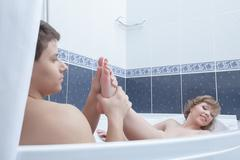 Sexy young couple in bathroom - stock photo