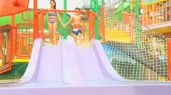 Caucasian Children Fun Riding Water Slide Stock Footage