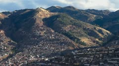 Cusco city in the hills pan across city - stock footage