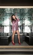 Fashion brunette woman in nightclub Stock Photos