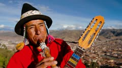 Traditional musician , Cusco in background Stock Footage