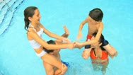 Stock Video Footage of Overhead Laughing Family Water Park Swimming Pool