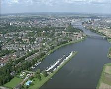 Aerial shot John F. Kennedy Bridge over river Meuse, Holland Stock Footage