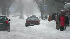 The strong snow cyclone in the city:bad weather,difficult traffic,extreme frost! Stock Footage