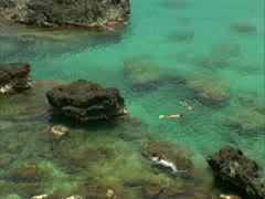 Snorkelers in Waimea Bay Stock Footage