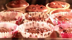 Muffins cooking in the oven Stock Footage
