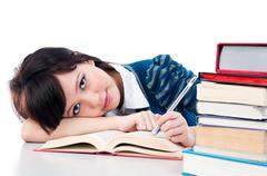 portrait of a cute female student resting on her arm over white background. - stock photo