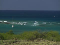 Hawaii Coastline, Surf and Sailboat - stock footage