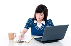 cute young woman working - stock photo
