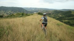 Cyclists riding in the African wilderness Stock Footage