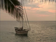 Sailboat Entering Harbor at Sunset Stock Footage