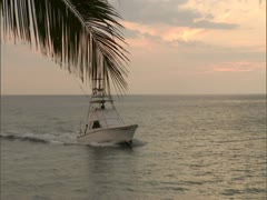 Sportfishing Boat Entering Harbor at Sunset Stock Footage