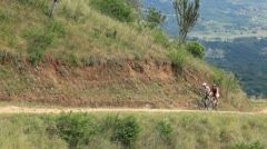 A pair of cyclist riding together . Stock Footage