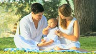 Loving Young Couple with Baby Girl Outdoors Sunshine Stock Footage
