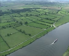 Aerial shot Cargo ship on River Meuse in hedgerow landscape Stock Footage