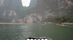 Guilin China Chinese water river raft boat beautiful mountain landscape Stock Footage