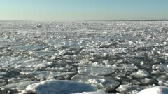 Pieces of ice moving on frozen sea Stock Footage