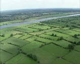 Stock Video Footage of Aerial shot Hedgerow landscape along River Meuse, Holland